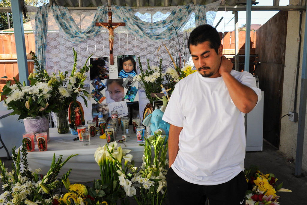 . Oscar Reyes mourns the deaths of his wife, Gissella Yauli, and 19-month-old son, Dillan Reyes, at a memorial at Oscar\'s brother\'s house, Monday, March 10, 2014. Their bodies were found in the burning garage of a South Los Angeles home, where the family had been living. (Photo by Michael Owen Baker/L.A. Daily News)