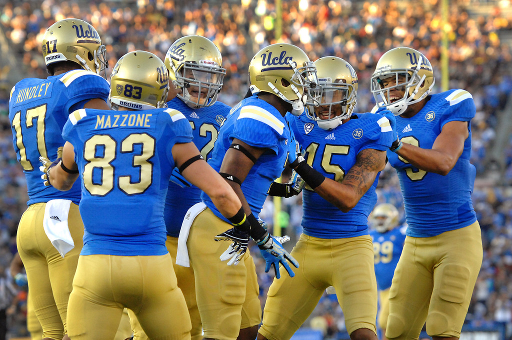 . UCLA WR Devin Fuller, center, is congratulated after scoring on a 76-yard pass against Colorado in the first quarter, Saturday, November 2, 2013, at the Rose Bowl. (Photo by Michael Owen Baker/L.A. Daily News)