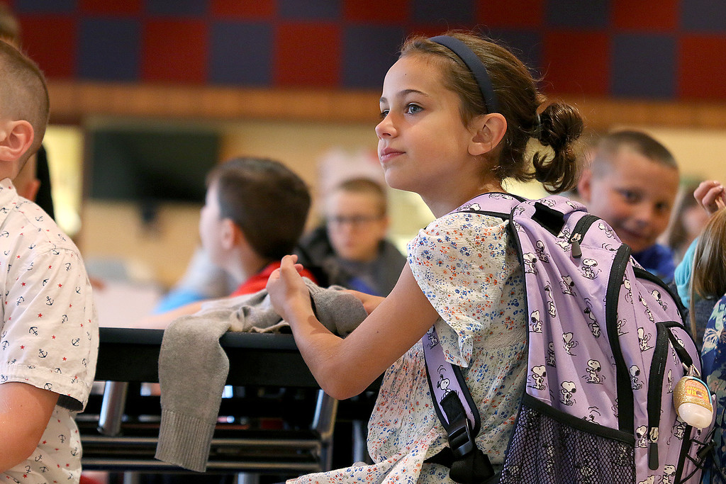 . The first day of the 2017-18 school year started on Tuesday for the J. R. Briggs Elementary School in Ashburnham. Second grader Ava Schorn, 7, sits in the schools cafeteria and waits for the school day to start. SENTINEL & ENTERPRISE/JOHN LOVE