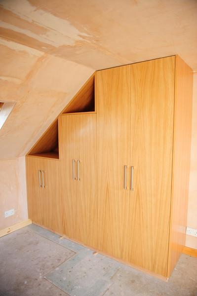 Oak veneered MDF wardrobes with triangular cubby holes