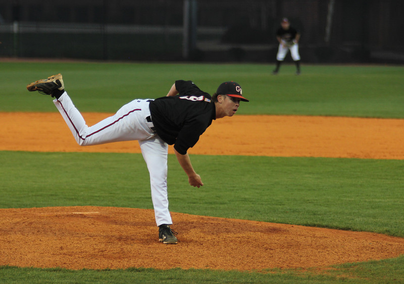 Emilio Pagan throws a pitch to a UNC-Asheville batter on Friday, March 18th, 2011.