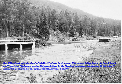 """Box Elder Creek after the flood of 6/9/72, 15"""" of rain in six hours.  The second bridge below the Box K Ranch on Nemo Road (Today it is next to Chipmunk Drive by the Meade/Pennington County line.  To the left is Pennington County and to the right is almost Lawrence County.)"""