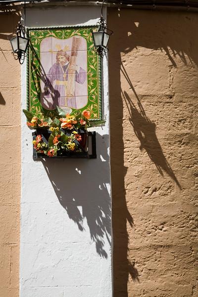 Image of Christ bearing the cross in glazed tiles on a wall, Cadiz, Spain