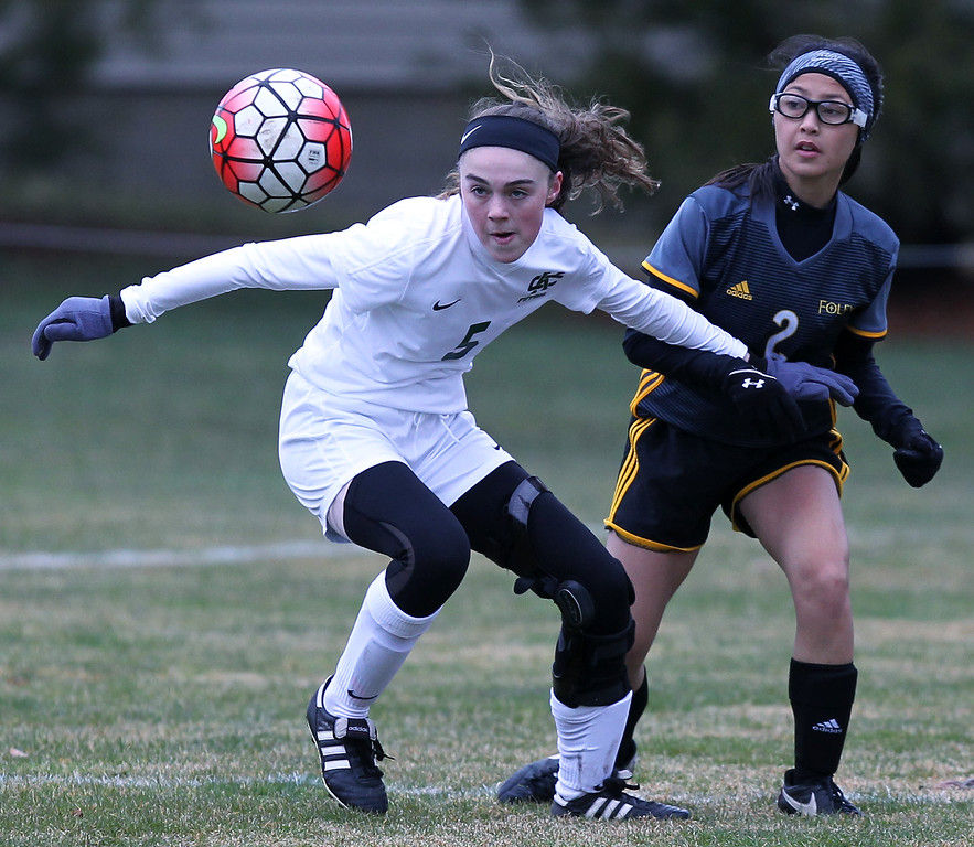 . Claudia Seiler (5), Cranbrook-Kingswood, gains ball possession in front of Marissa Bui (2), Madison Heights Bishop Foley, during varsity soccer action at Cranbrook-Kingswood Saturday, April 14, 2018. The Cranes fell to Foley 2-0. (For The Oakland Press / LARRY McKEE)
