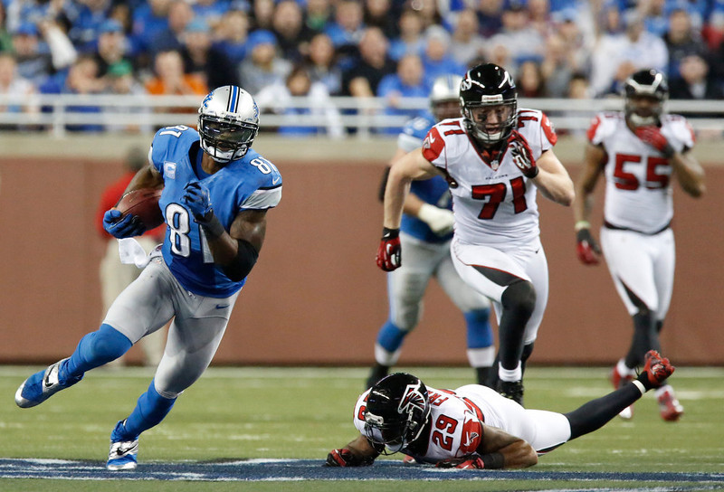 . Detroit Lions wide receiver Calvin Johnson (81) breaks away from Atlanta Falcons defensive back Dominique Franks (29) during the third quarter of an NFL football game at Ford Field in Detroit, Saturday, Dec. 22, 2012. (AP Photo/Duane Burleson)