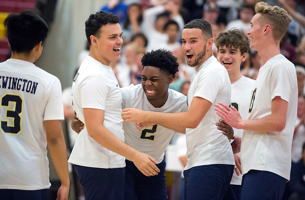 06/04/19 Wesley Bunnell | Staff Newington volleyball defeated Wethersfield 3-0 in a semifinal game at New Britain High School on Tuesday night. Celebrating a point are Julian Ortiz (16), Louis Egbuna (2), Leonel Caceres (13).