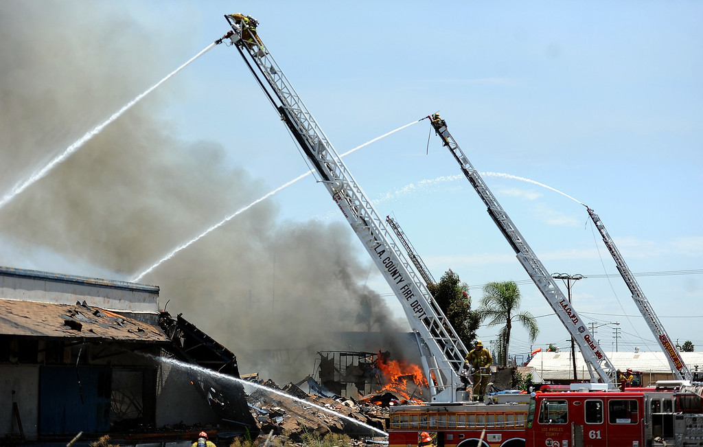 . Los Angeles County firefighters battle a 3-alarm fire at an abandoned warehouse near 9th Avenue and Clark Avenue on Tuesday, July 9, 2013 in City of Industry, Calif.  (Keith Birmingham/Pasadena Star-News)