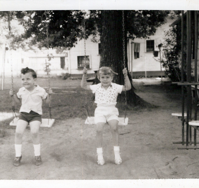 1956 Butch on a swing with friend.jpeg