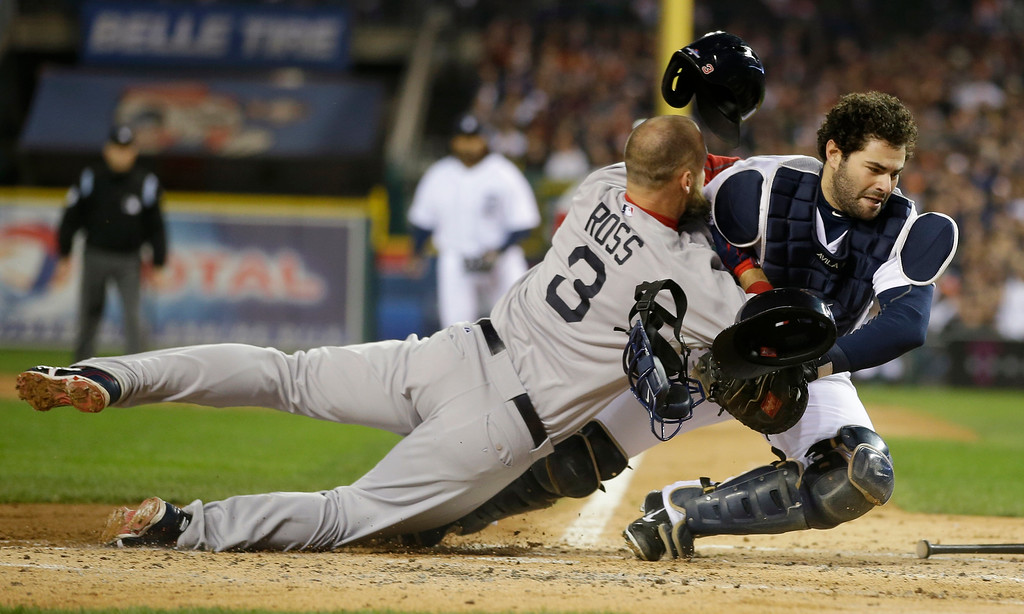. Boston Red Sox\'s David Ross is out at home on a fielder choice collides with Detroit Tigers catcher Alex Avila in the second inning during Game 5 of the American League baseball championship series Thursday, Oct. 17, 2013, in Detroit. (AP Photo/Matt Slocum)
