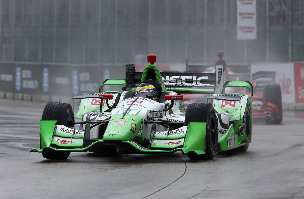 . Sebastien Bourdais, of France, drives in the rain during the second race of the IndyCar Detroit Grand Prix auto racing doubleheader Sunday, May 31, 2015, in Detroit. (AP Photo/Dave Frechette)