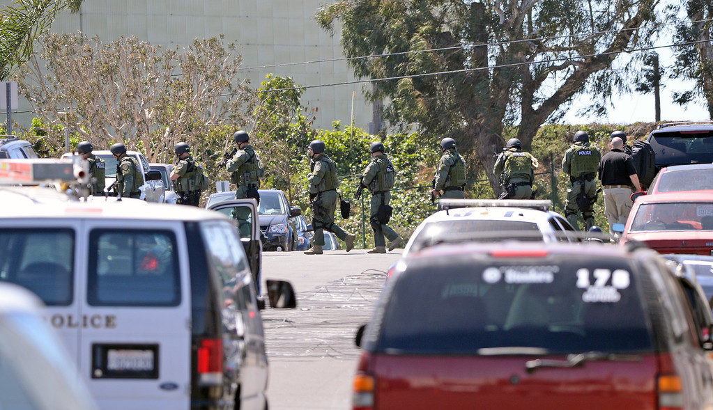 . SWAT team moves into position in El Segundo at the Popcornopolis offices near El Segundo Blvd. An armed female employee took another employee hostage, which ended peacefully  four hours later about noon. Photo by Brad Graverson 4-16-13