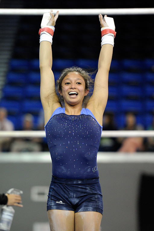 . UCLA Vanessa Zamarripa smiles after a dismount from the bars, Thursday, April 18, 2013, for the upcoming NCAA Women\'s Gymnastics Championships at Pauley Pavilion. (Michael Owen Baker/Staff Photographer)