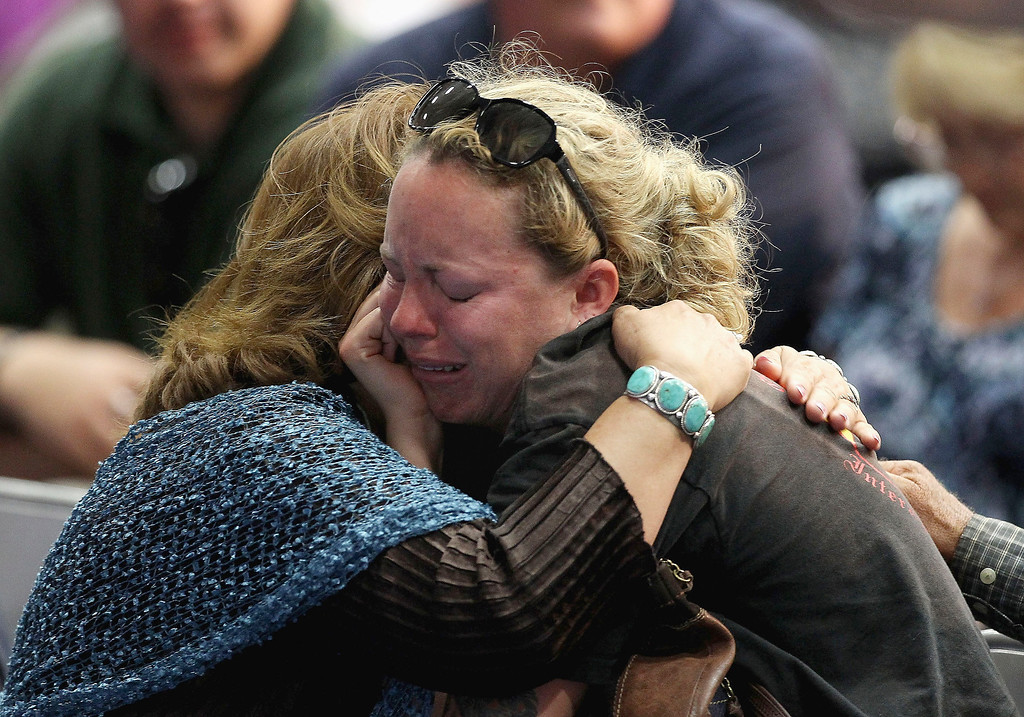 . Claire Caldwell (R), wife of fallen firefighter Robert Caldwell, grieves during a memorial service at EmbryRiddle Aeronautical University on July 1, 2013 in Prescott, Arizona.  (Photo by Christian Petersen/Getty Images)