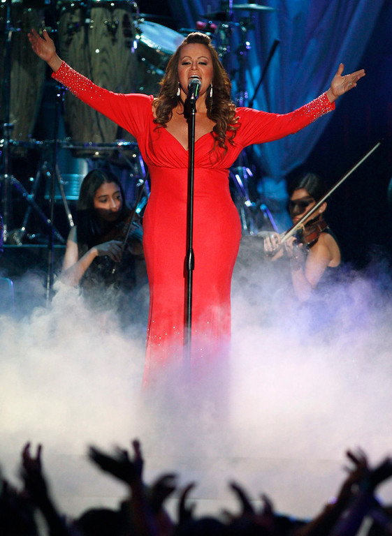 . Mexican-American singer Jenni Rivera performs during the 2012 Billboard Latin Music Awards in Coral Gables, Florida in this April 26, 2012 file photo. Rivera is missing after the plane she was travel ling in disappeared shortly after leaving the northern Mexican city of Monterrey early on December 9, 2012. Rivera was heading for the city of Toluca in central Mexico after a concert in Monterrey on the night of December 8, 2012. The singer, two pilots and four other passengers are all missing, the ministry said. A search is continuing for the aircraft.     REUTERS/Andrew Innerarity/Files
