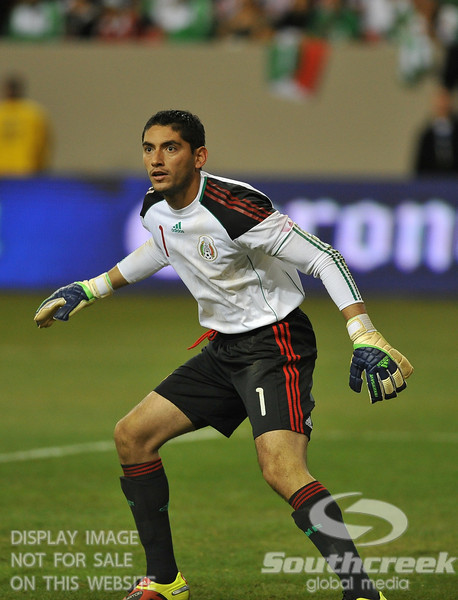 Mexico's Goalkeeper Jesus Corona (#1) waits for the shot in Soccer action between Bosnia-Herzegovina and Mexico.  Mexico defeated Bosnia-Herzegovina 2-0 in the game at the Georgia Dome in Atlanta, GA.