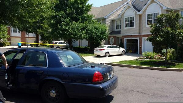 . Police have a home where a woman was reportedly shot on Harvard Drive in Montgomery Township cordoned off Monday, June 2, 2014. (Photo by Dan Sokil)