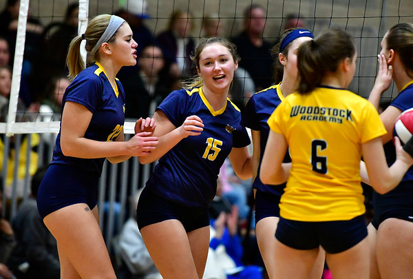 11/14/2018 Mike Orazzi | Staff Woodstock Academy's Natalie Low (22) and Samantha Orlowski (15) during the Class L Semifinal State Girls Volleyball Tournament held at Windsor High School Wednesday night.
