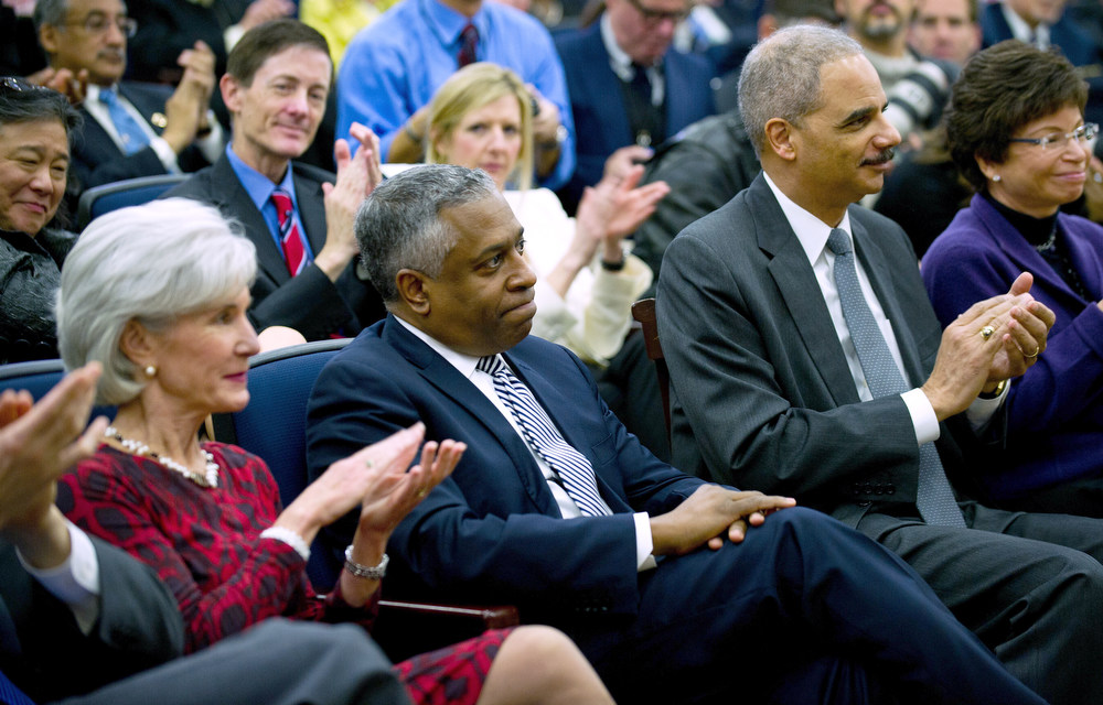 . Acting Director of the US Bureau of Alcohol, Tobacco, Firearms and Explosives Todd Jones (C) is applauded by US Attorney General Eric Holder (2nd R), US Secretary of Health and Human Services Kathleen Sebelius (L) during an event unveiling a package of proposals to reduce gun violence at the White House in Washington, DC, January 16, 2013. Obama signed 23 executive orders to curb gun violence and demanded Congress pass as assault weapons ban, in  a sweeping set of measures in response to the Newtown massacre.               AFP Photo/Jim  WATSON/AFP/Getty Images