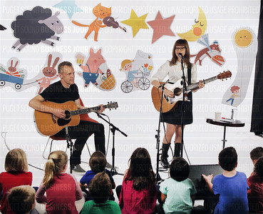 Lisa Loeb performs children rhyme songs for a live audience of Amazon employee children during a videotaping of her performance at Amazon headquarters in Seattle, Washington