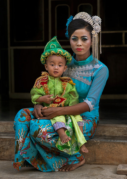 Mother and son dressed up for the novice ceremony.  Mandalay, Myanmar, 2017