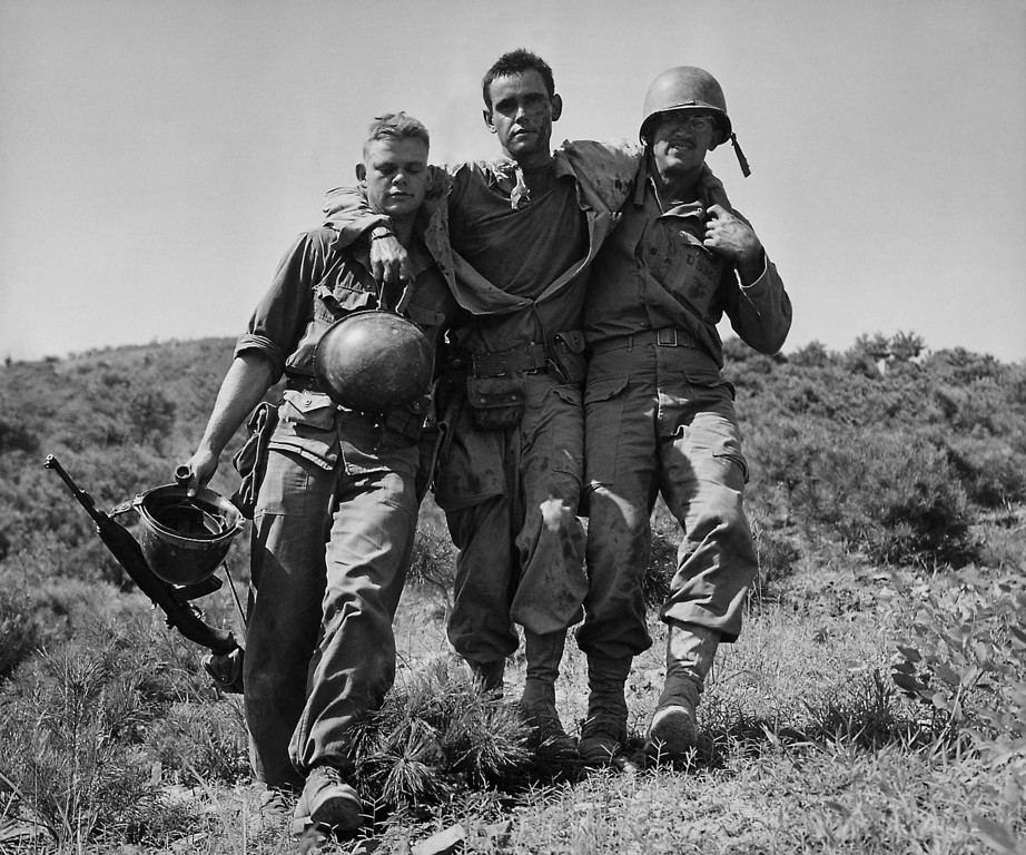 ". U.S. Marines help a wounded buddy on the Naktong River front in South Korea.  The war that began in Korea 60 years ago, on June 25, 1950, a ghastly conflict that killed millions and left the peninsula in ruins, became ""The Forgotten War\"" in many American minds. (AP Photo/Max Desfor)"
