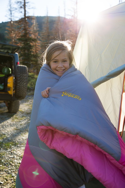 a young girl in a sleeping bag