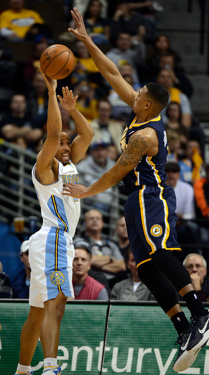 . DENVER, CO. - JANUARY 28: Indiana Pacers shooting guard Orlando Johnson (11) forces Denver Nuggets point guard Andre Miller (24) to make a pass during the second quarter January 28, 2013 at Pepsi Center. The Denver Nuggets host  the Indiana Pacers in NBA Action. (Photo By John Leyba / The Denver Post)