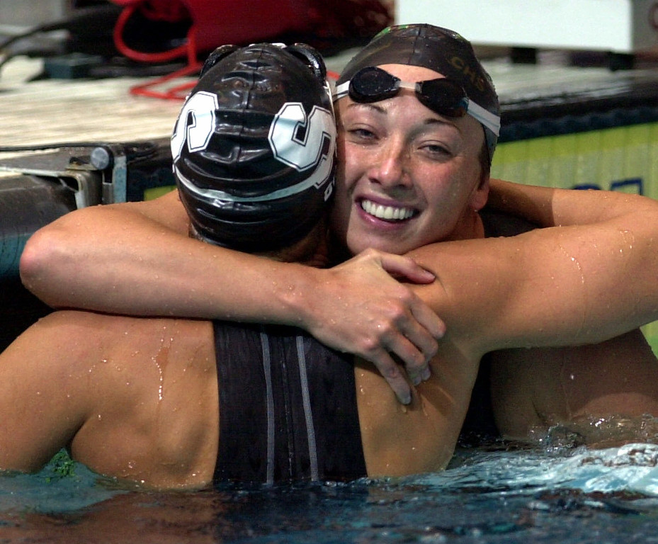 . In this Aug. 16, 2000 file photo, Amy Van Dyken, right, of Lone Tree, Colo., hugs Dara Torres of Palo Alto, Calif., after Torres won the finals of the women\'s 50-meter freestyle at the U.S. Olympic Swimming Trials in Indianapolis. (AP Photo/Chris O\'Meara, File)