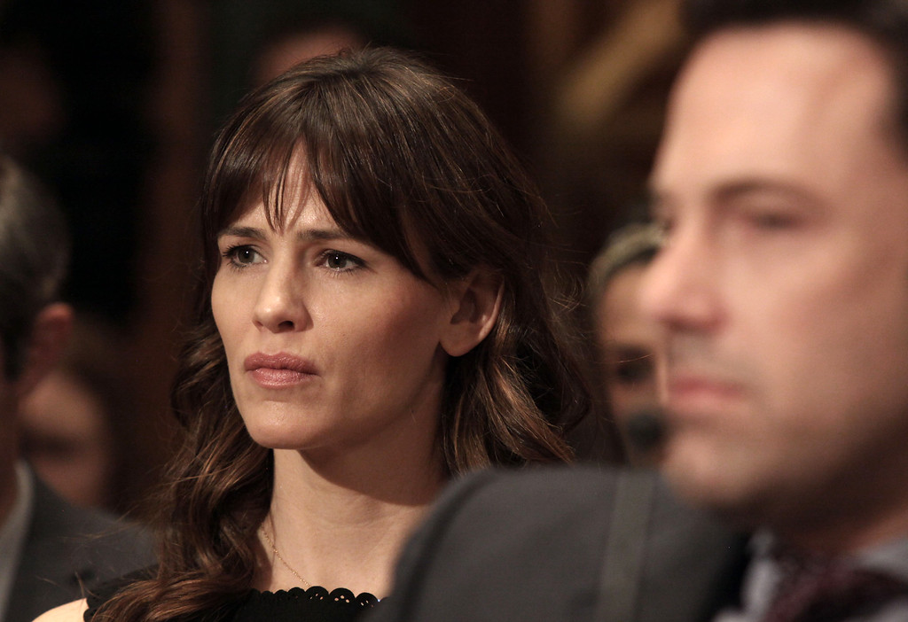. Actress Jennifer Garner listens to testimony on Capitol Hill in Washington, Thursday, March 26, 2015, during a Senate State, Foreign Operations, and Related Programs subcommittee hearing on diplomacy, development and national security, where her husband, Ben Affleck, right, testified. Garner and Affleck filed divorce petitions on Thursday, April 13, 2017, the first step in formally ending their marriage more than a year after they publicly declared their relationship was over. (AP Photo/Lauren Victoria Burke)