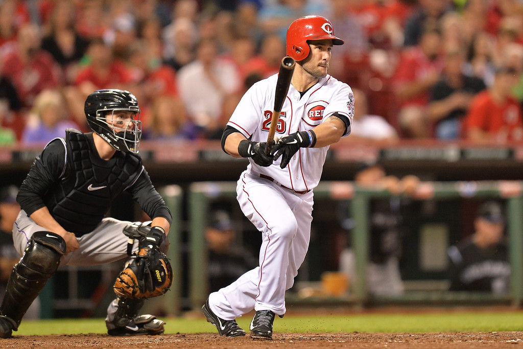 . CINCINNATI, OH - MAY 10: Skip Schumaker #25 of the Cincinnati Reds singles in the fifth inning against the Colorado Rockies at Great American Ball Park on May 10, 2014 in Cincinnati, Ohio. Colorado defeated Cincinnati 11-2. (Photo by Jamie Sabau/Getty Images)
