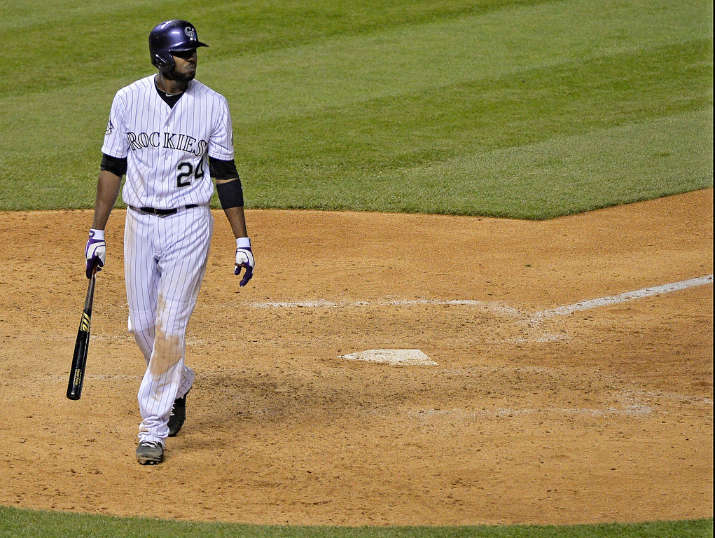 . Dexter Fowler (24) of the Colorado Rockies walks off after striking out for the third out during the ninth inning May 16, 2013 at Coors Field. The Giants defeated the Rockies 8-6. (Photo By John Leyba/The Denver Post)