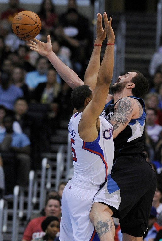 . Clippers#6 DeAndre Jordan gets in front of Timberwolves#14 Nikola Pekovic. The Clippers defeated the Minnesota Timberwolves 111-95 in a game played at Staples Center in Los Angeles, CA 4/10/2013(John McCoy/Staff Photographer
