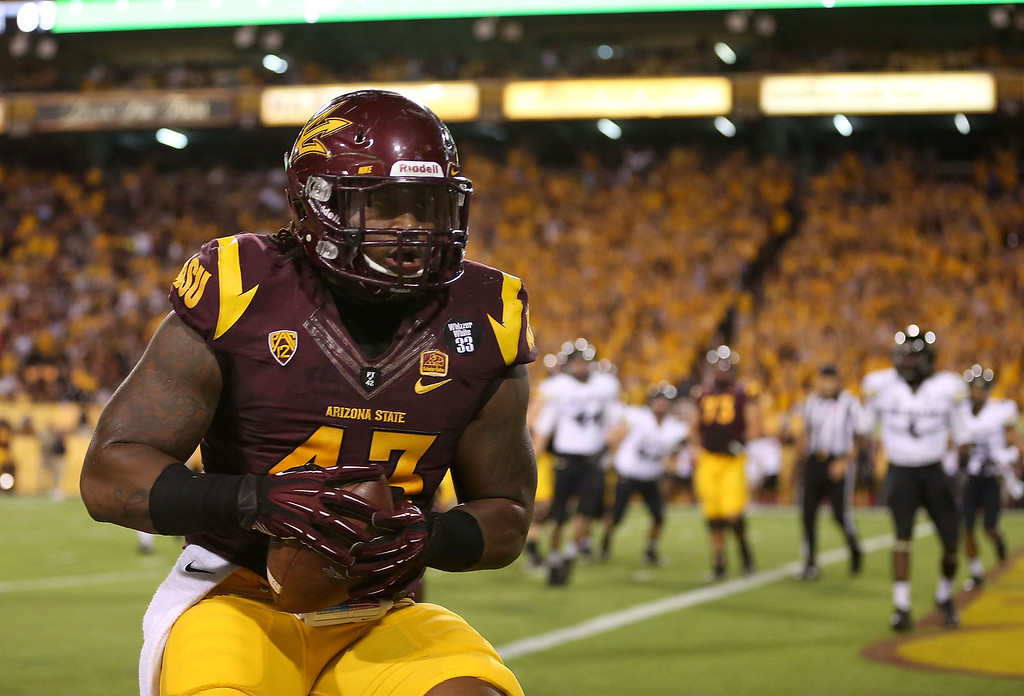 . TEMPE, AZ - OCTOBER 12:  Defensive end Davon Coleman #43 of the Arizona State Sun Devils scores on a 1 yard touchdown reception against the Colorado Buffaloes during the second quarter of the college football game at Sun Devil Stadium on October 12, 2013 in Tempe, Arizona.  (Photo by Christian Petersen/Getty Images)