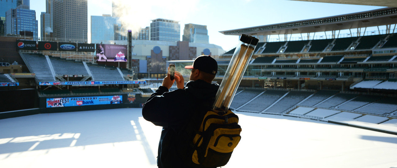 . James Markfort from Big Lake takes a panoramic photo of the frozen and snow covered Target Field while at Twinsfest, Saturday, January 25, 2014. (Pioneer Press: John Autey)