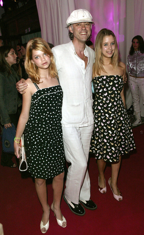 """. Bob Geldof and daughters Peaches and Pixie pose at the after-party for the\' film \""""Charlies Angels 2: Full Throttle\"""" at the In and Out Club on July 1, 2003 in London. The film will be released nationwide on July 4, 2003. (Photo by Dave Hogan/Getty Images)"""
