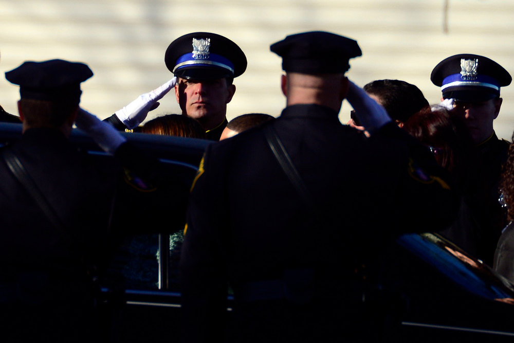 Description of . The color guard stands during the funeral procession for Victoria Soto, 27, in Stratford, Connecticut on Wednesday, December 19, 2012. Soto, a first grade teacher, was shot and killed during the Newton shooting as she attempted to protect her students against the gunman. AAron Ontiveroz, The Denver Post