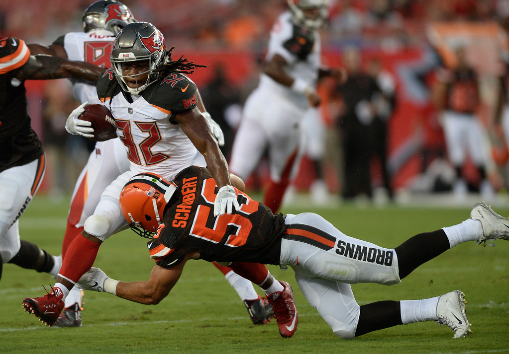 . Tampa Bay Buccaneers running back Jacquizz Rodgers his hit by Cleveland Browns outside linebacker Joe Schobert (53) during the first quarter of an NFL preseason football game Saturday, Aug. 26, 2017, in Tampa, Fla. (AP Photo/Jason Behnken)