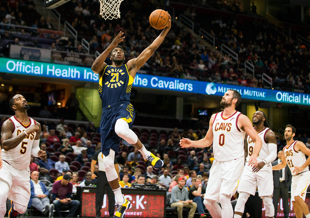 . Indiana Pacers\' Thaddeus Young (21) makes an open shot on the basket against the Cleveland Cavaliers during the third quarter of an NBA preseason basketball game, Friday, Oct. 6, 2017, in Cleveland. The Pacers won 106-102. (AP Photo/Scott R. Galvin)