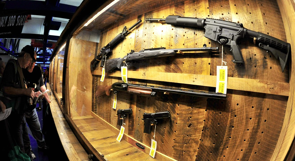 """. Some of  several hundred weapons that will be raffled off, are displayed on the \""""Wall of Guns\"""" at the NRA (National Rifle Association) Convention May 4, 2013 in Houston, Texas. KAREN BLEIER/AFP/Getty Images"""