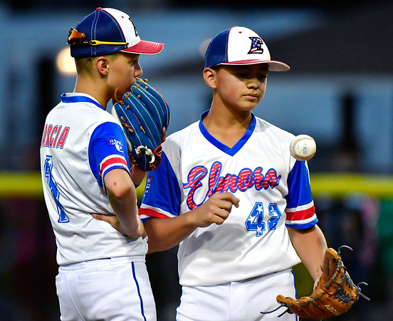 8/10/2019 Mike Orazzi | Staff New Jersey Elmora Youth Little League's Sal Garcia (1) and J.R. Rosado (42) during Saturday's Mid Atlantic Final baseball game with New York at Breen Field in Bristol, Conn.