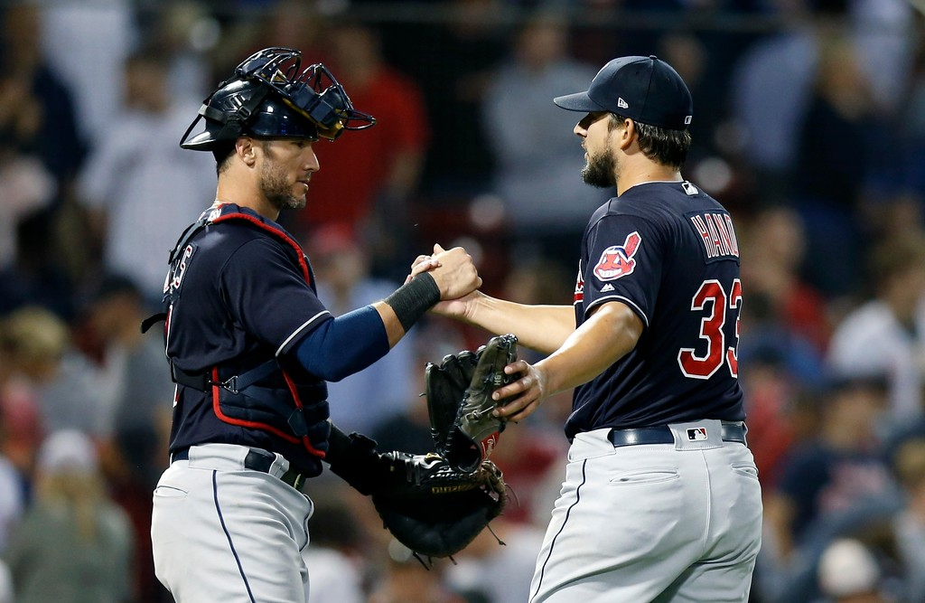 . Cleveland Indians\' Brad Hand (33) and Yan Gomes celebrate after defeating the Boston Red Sox during a baseball game in Boston, Tuesday, Aug. 21, 2018. (AP Photo/Michael Dwyer)
