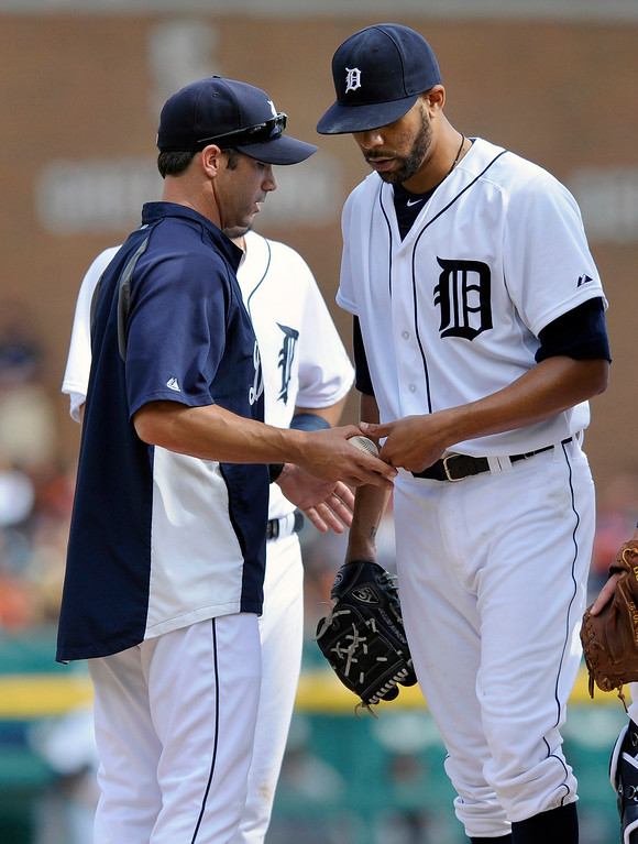 . Detroit Tigers pitcher David Price, right, gives the ball to manager Brad Ausmus as he leaves in the ninth inning of a baseball game against the San Francisco Giants, Saturday, Sept. 6, 2014, in Detroit. The Giants won 5-4.  (AP Photo/Jose Juarez)