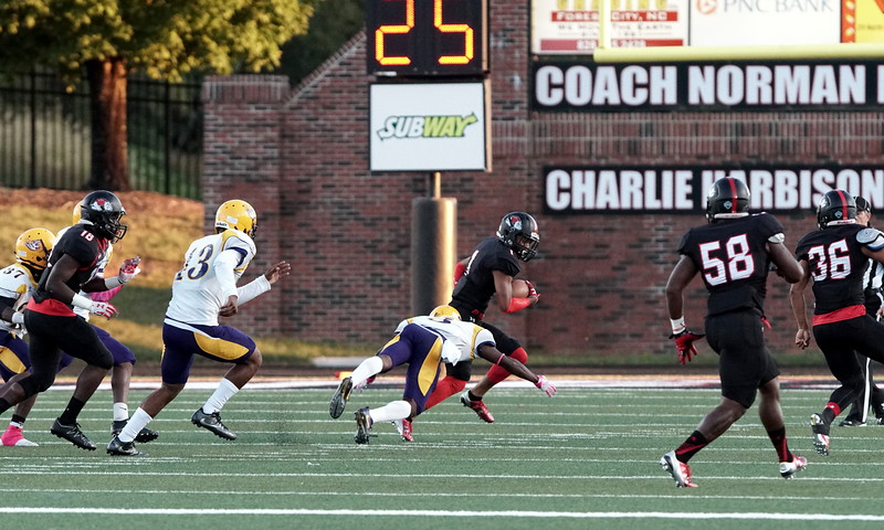 Number 1, Triston Dozier, being tackled by Benedict. -Ashley Falls
