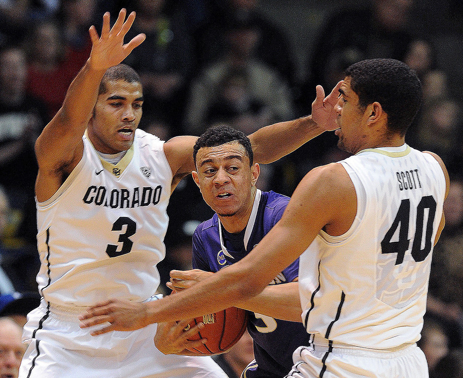 . Xavier Talton, left, of Colorado, and Josh Scott (40), trap Nigel Williams-Goss of Washington during the first half of the February 9, 2014 game in Boulder, Colo. (Cliff Grassmick /Daily Camera)