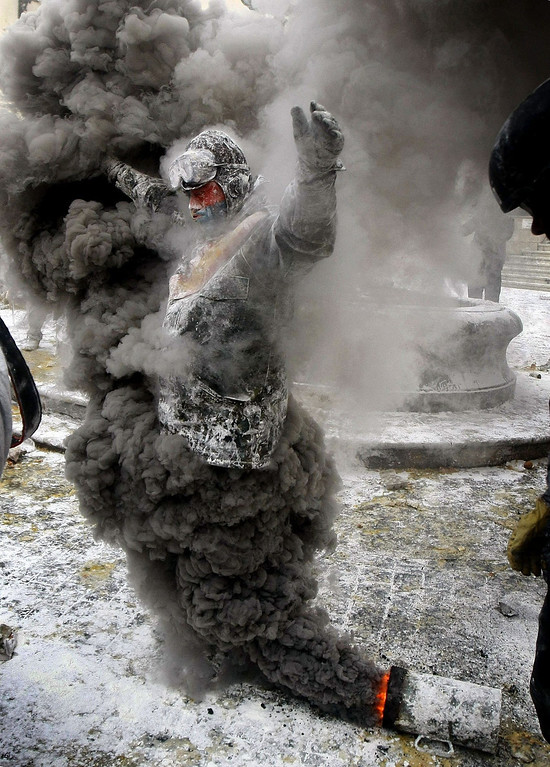 . A man takes part in the traditional winter event \'Els Enfarinat\', a battle with flour, eggs and firecrackers to raise money for charity, in Ibi, Alicante province, eastern Spain, 28 December 2013. \'Els Enfarinats\', which means, in Valencian language, \'The floured (people)\', is celebrated in Ibi on occasion of 28 December, Spanish day marking the Holy Innocents Day, a kinf of April Fools\' day.  EPA/Manuel Lorenzo