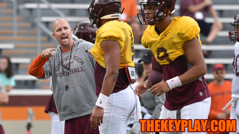 Offensive Coordinator/ Quarterbacks coach Brad Cornelsen gives instructions to quarterback Jerod Evans. (Michael Shroyer/ TheKeyPlay.com)