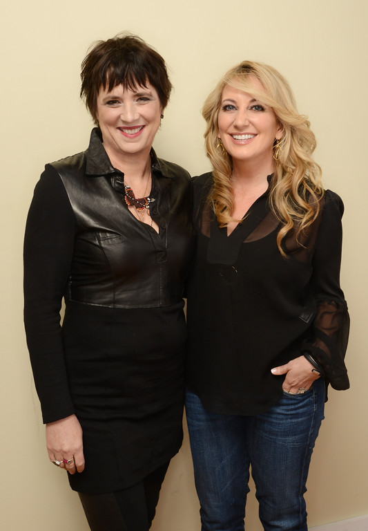 . Playwright Eve Ensler (L) and singer-songwriter Lee Ann Womack pose for a portrait during the 2014 Sundance Film Festival at the Getty Images Portrait Studio at the Village At The Lift on January 22, 2014 in Park City, Utah.  (Photo by Larry Busacca/Getty Images)