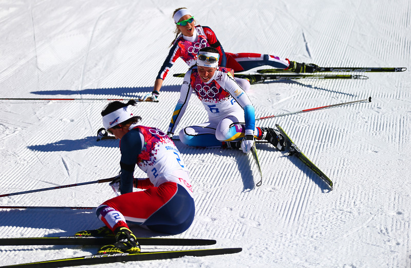 . Marit Bjoergen (bottom) of Norway, Charlotte Kalla (C) of Sweden and Therese Johaug of Norway collapse on the snow after competing in the Ladies\' Skiathlon 7.5 km Classic + 7.5 km Free during day one of the Sochi 2014 Winter Olympics at Laura Cross-country Ski & Biathlon Center on February 8, 2014 in Sochi, Russia.  (Photo by Clive Mason/Getty Images)