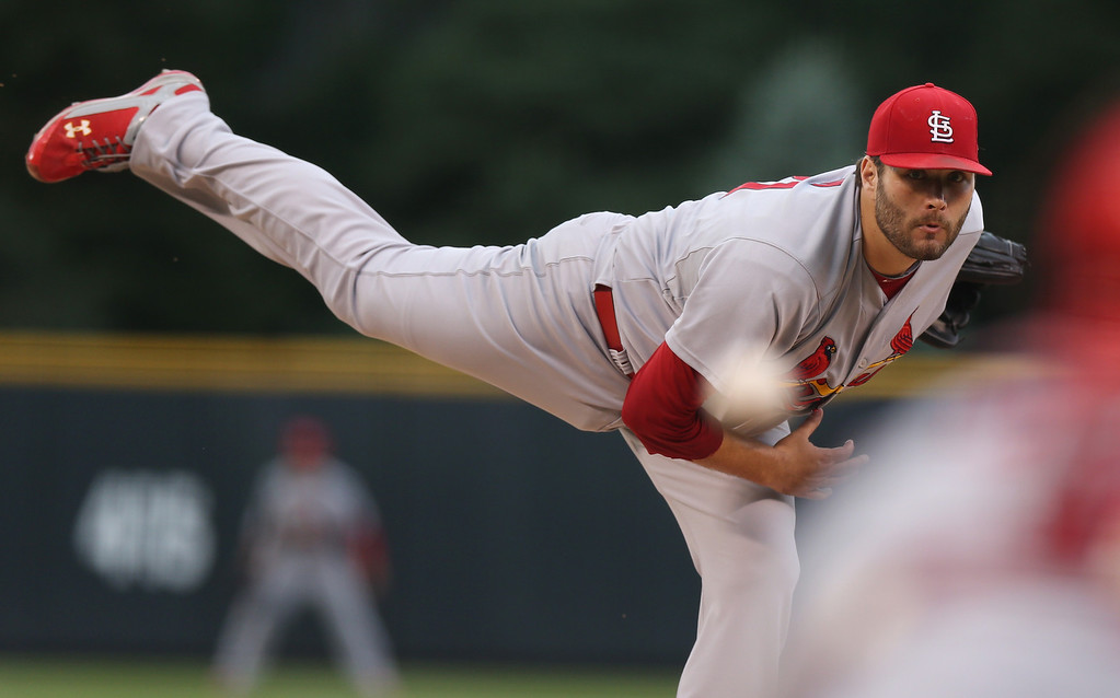 . St. Louis Cardinals starting pitcher Lance Lynn delivers a pitch against the Colorado Rockies in the first inning of a baseball game in Denver on Monday, June 23, 2014. (AP Photo/David Zalubowski)