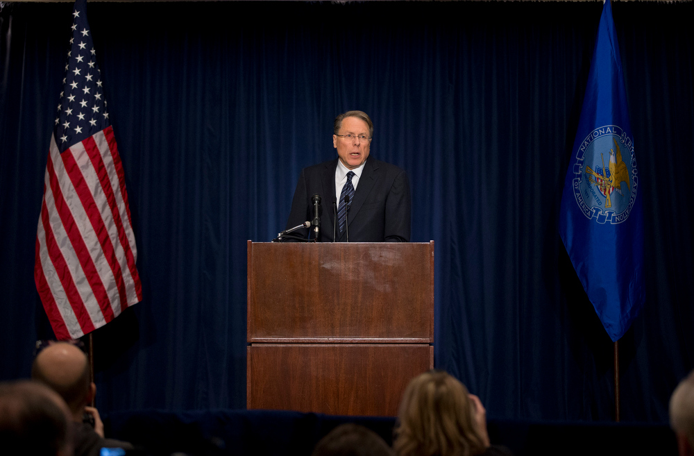 Description of . The National Rifle Association executive vice president Wayne LaPierre, speaks during a news conference in response to the Connecticut school shooting on Friday, Dec. 21, 2012 in Washington.  The nation's largest gun-rights lobby is calling for armed police officers to be posted in every American school to stop the next killer